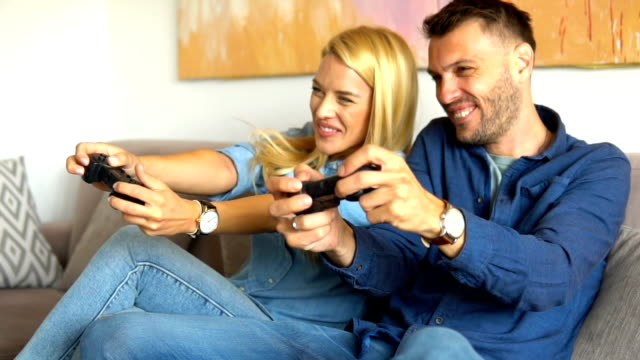 couple playing video games - gamepad stock videos & royalty-free footage