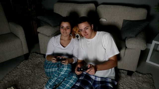 couple playing videogames in the living room - winning stock videos & royalty-free footage