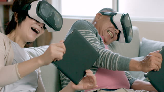 couple playing with virtual reality headsets - cyberspace stock videos & royalty-free footage