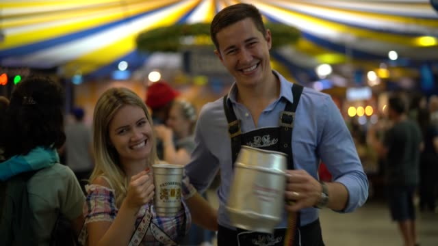 couple portrait at oktoberfest in blumenau, santa catarina, brazil - german culture stock videos & royalty-free footage