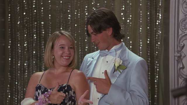 a couple poses for a picture at the prom. - high school prom stock videos & royalty-free footage