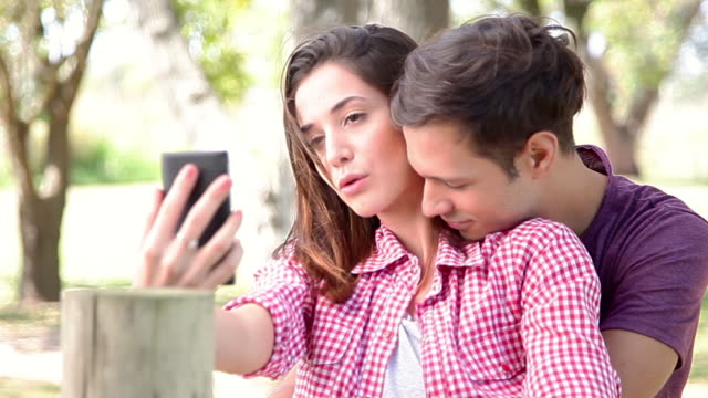 Couple posing for a selfie outdoors