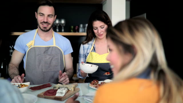 couple preparing food for their friends - brunch stock videos and b-roll footage