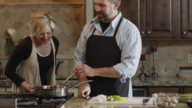 vídeos y material grabado en eventos de stock de ms tu couple preparing food in kitchen / orem, utah, usa - orem