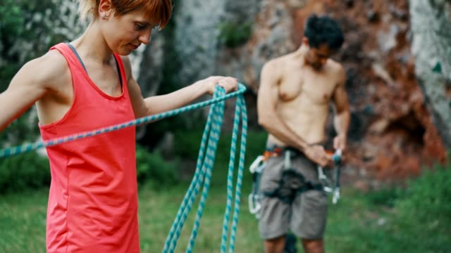 couple preparing for rock climbing - climbing equipment stock videos & royalty-free footage