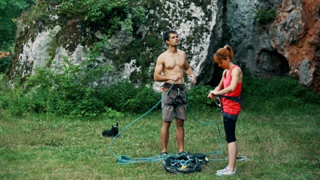 couple preparing for rock climbing - krab stock videos & royalty-free footage