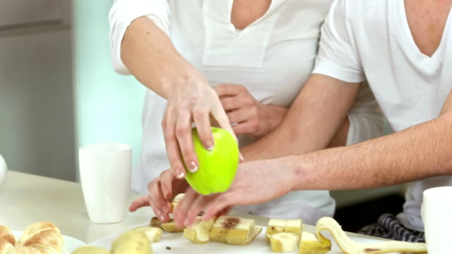 Couple Preparing Healthy Breakfast