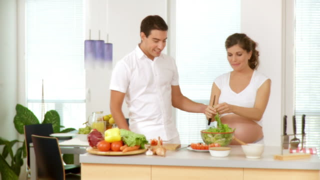 hd dolly: couple preparing lunch - prenatal care stock videos & royalty-free footage