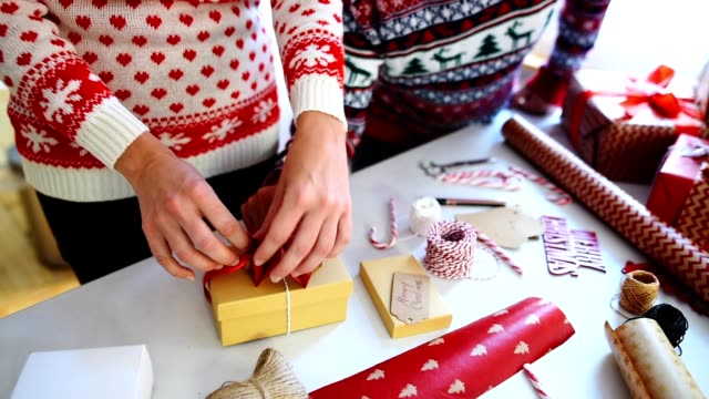 couple preparing the packages for christmas - rustic stock videos & royalty-free footage