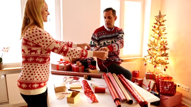 couple preparing the packages for christmas - gift box stock videos & royalty-free footage