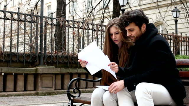 couple reading letter and responds - receiving stock videos & royalty-free footage