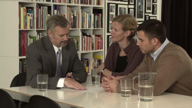 MS Couple receiving advice from financial advisor / Copenhagen, Denmark