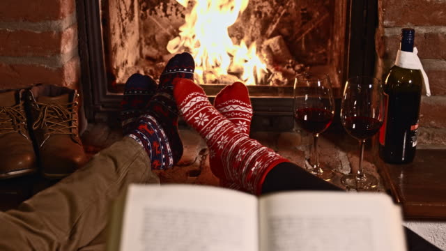 ds r/f couple relaxing by the fireplace - log cabin stock videos & royalty-free footage