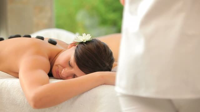 couple relaxing in a spa - massage table stock videos & royalty-free footage