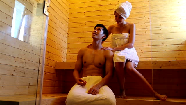 couple relaxing in sauna together - sauna stock videos and b-roll footage
