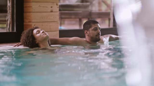 Couple relaxing in spa pool