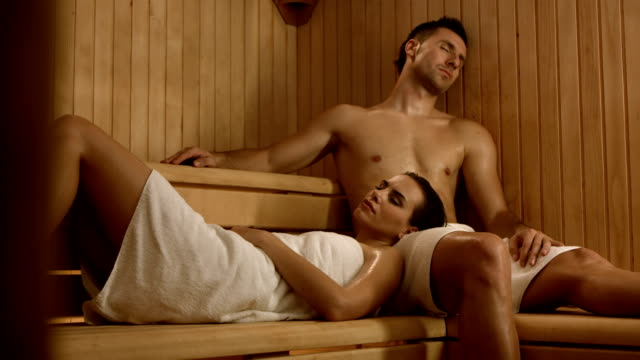 hd dolly: couple relaxing in the sauna - sauna stock videos & royalty-free footage