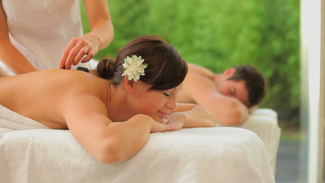 couple enjoying in the spa - lastone therapy stock videos and b-roll footage