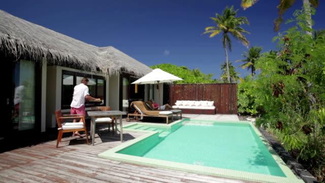 couple relaxing on island terrace