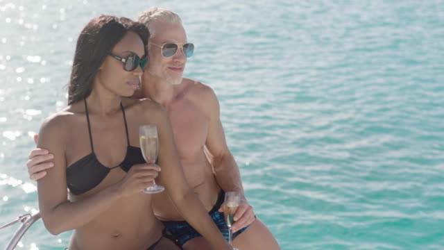 couple relaxing on luxury yacht - bikini bottom stock videos & royalty-free footage