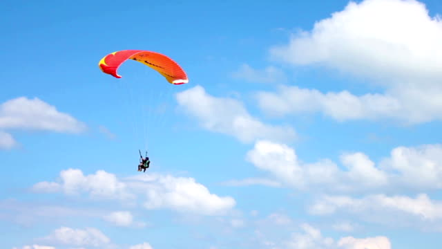 couple relaxing on the sea - paragliding stock videos & royalty-free footage