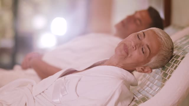 couple relaxing on warm tepidarium at the spa - health resort stock videos & royalty-free footage