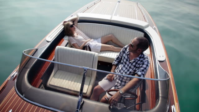 couple relaxing on yacht - speed boat stock videos & royalty-free footage