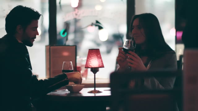 vídeos de stock e filmes b-roll de couple relaxing with a glass of wine - food and drink
