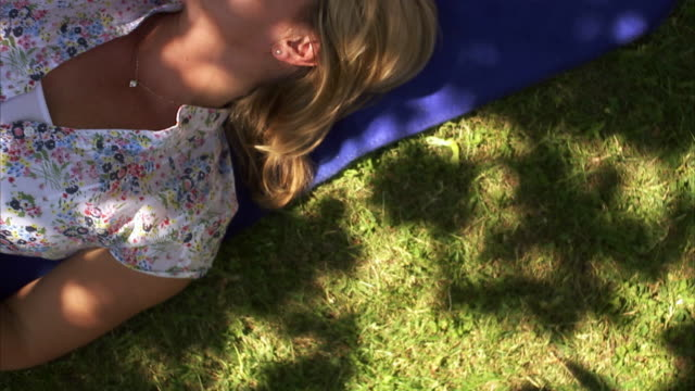couple resting in a park sweden. - sideways glance stock videos & royalty-free footage