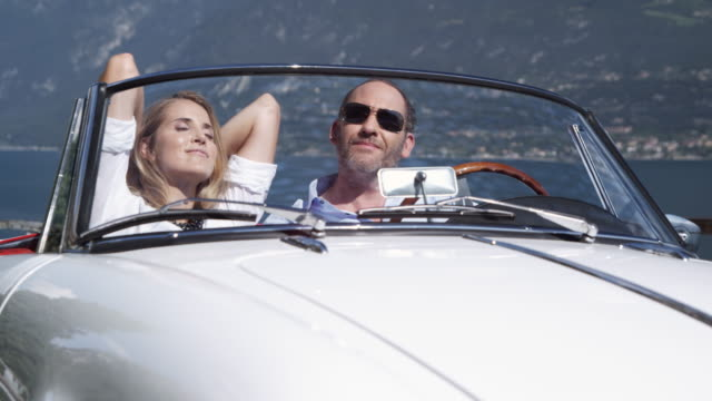 couple resting in car - classic car stock videos and b-roll footage