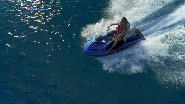 couple riding a jet boat - jet ski stock videos & royalty-free footage
