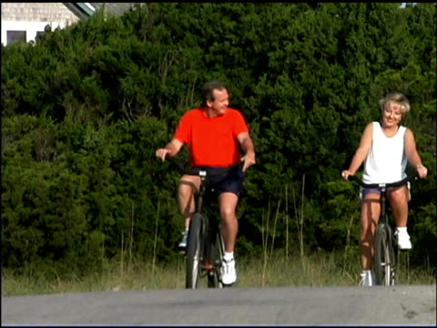 couple riding bicycles outdoors - see other clips from this shoot 1335 stock videos and b-roll footage