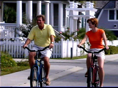 couple riding bicycles - see other clips from this shoot 1335 stock videos and b-roll footage