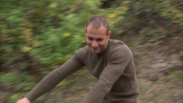 ms zo rear pov couple riding bikes in woods / provo, utah, usa - provo stock videos & royalty-free footage