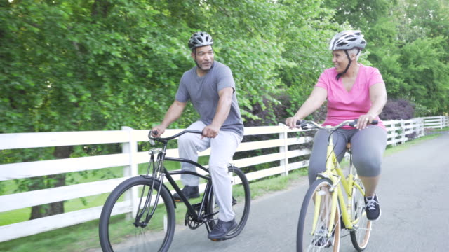 couple riding bikes - husband stock videos & royalty-free footage