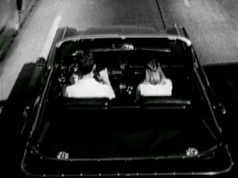 vidéos et rushes de couple riding in convertible car female passenger taking tape out of glove compartment ms female hand sliding 4track 'cartridge' into under dash... - glisser