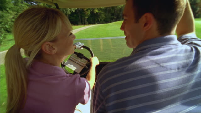 cu, pov, couple riding in golf cart on golf course, seco, maine, usa - golf cart stock videos & royalty-free footage