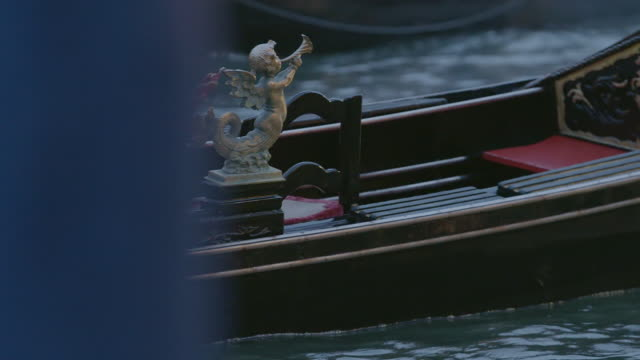 MS PAN Couple riding in gondola through canal / Venice, Italy