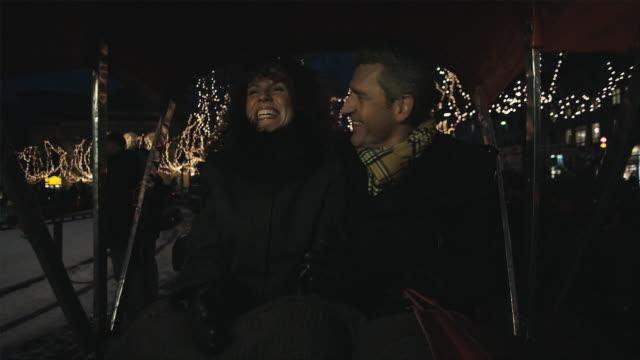 ms couple riding in rickshaw and woman opening gift / copenhagen, denmark - 異性情侶 個影片檔及 b 捲影像