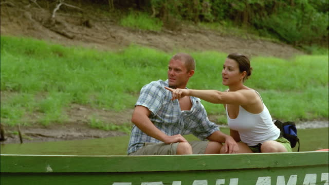 stockvideo's en b-roll-footage met couple riding in tour boat on negro river in amazon / brazil - color negro