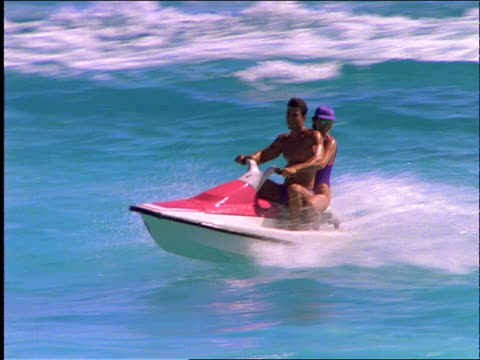 couple riding jet boat on ocean / cancun - jet ski stock videos & royalty-free footage