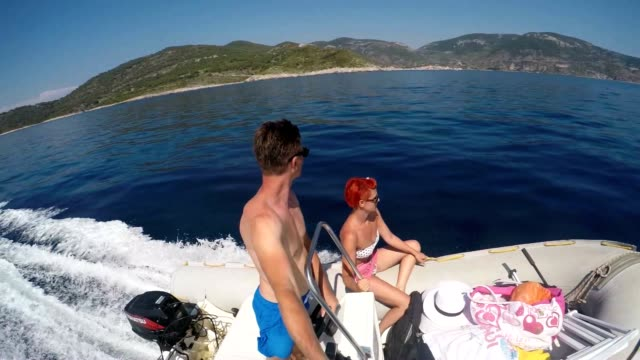 SLO MO POV Couple riding on a motorboat