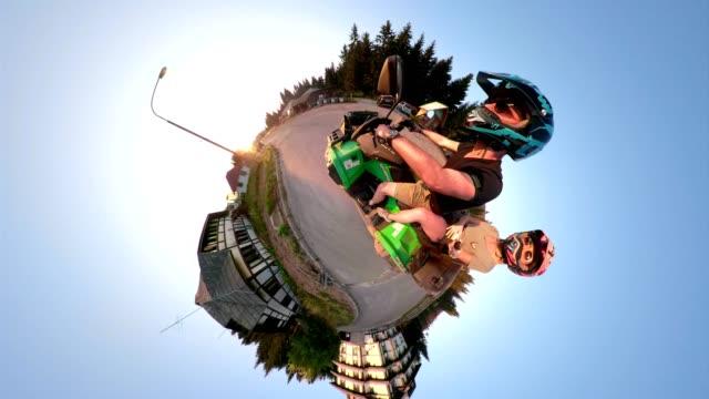 par ridning på en fyrhjulningssafari - tillverkat objekt bildbanksvideor och videomaterial från bakom kulisserna