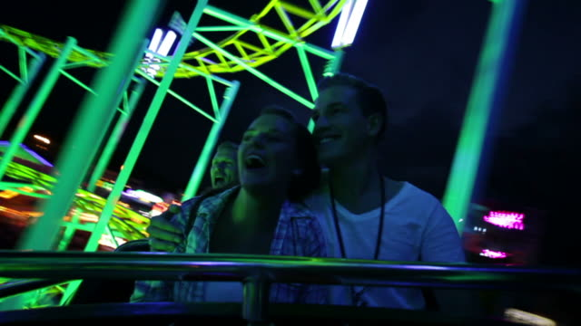 couple riding rollercoaster (part 3/3) - rollercoaster stock videos & royalty-free footage