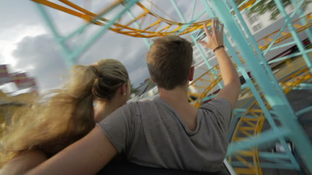 Couple riding Rollercoaster