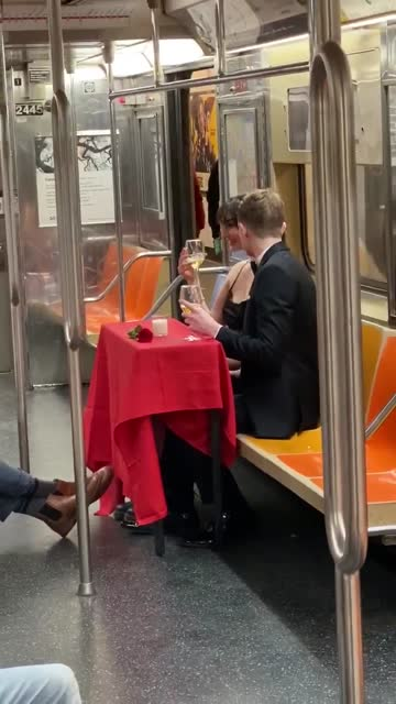 couple riding the subway are wearing formal attire while sitting at the table with red tablecloth they brought for the photoshoot. they hold wine... - dinner jacket stock videos & royalty-free footage