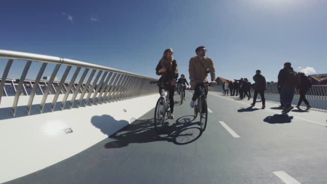 Couple riding urban road city bicycles
