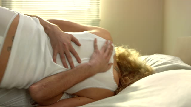 couple rolling around on the bed - couple relationship videos stock videos & royalty-free footage