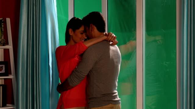 Couple romancing at home, Delhi, India