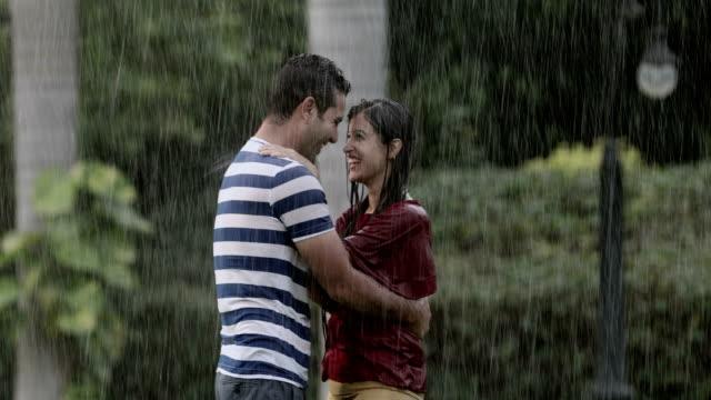 Couple romancing in the rain season, Delhi, India